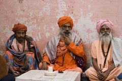 Three Wise Men. These are Babas (Sadhu) or spiritual wander in Pushkar, India. They are wearing traditional Indian clothes and turbans. Baba are people who have stock photo