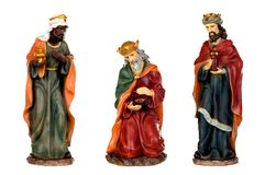 The three wise men and baby Jesus. Ceramic figures isolated on white background stock images