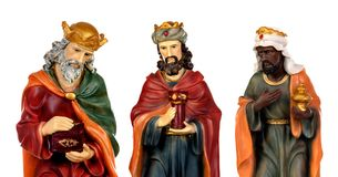 The three wise men and baby Jesus. Ceramic figures isolated on white background royalty free stock photography