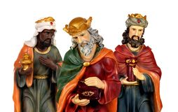 The three wise men and baby Jesus. Ceramic figures isolated on white background stock photography