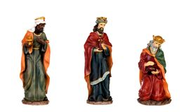 The three wise men and baby Jesus. Ceramic figures isolated on white background royalty free stock photo
