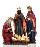 The three wise men and baby Jesus. Ceramic figures isolated on white background stock photos