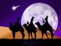 Three wise men on camels Stock Photo