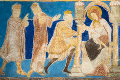 The three wise men carry out their gifts to the baby Jesus. Romanesque fresco. The holy kings bring their gifts to the Christ child. Bjaresjo churh, Sweden, Sept Royalty Free Stock Image