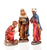 The three wise men. Ceramic figures isolated on white background stock image
