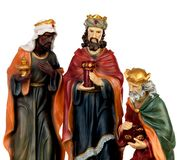 The three wise men. Ceramic figures isolated on white background royalty free stock image