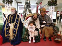 Three wise men, reyes magos. MADRID, SPAIN - DECEMBER 28: Three wise men with a little girl posing for picture in a shopping centre in December 28, 2017 in Legan Stock Photo