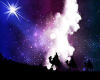 Three wise men by a star on the background of cosmic sky Stock Photography