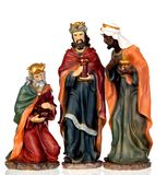The three wise men. Ceramic figures isolated on white background royalty free stock photos