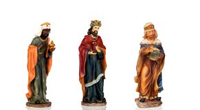 The three wise men. Ceramic figures isolated on white background stock images