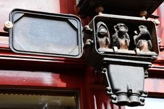 Three wise monkeys small sculptural group placed in antique electric clock fuse box. Shot in Banska Stiavnica, Slovakia royalty free stock photo