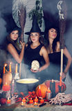 Three witch with a skull.tinted Stock Photos