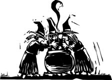 Three Witches. Stand over a boiling cauldron Stock Image