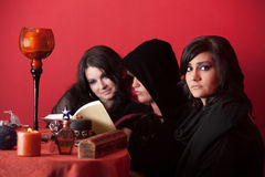 Three Witches Reading Stock Photo