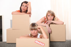 Three woman with cardboard boxes Royalty Free Stock Image
