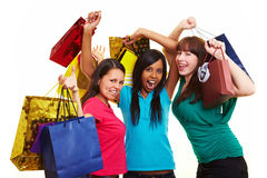 Three woman cheering while shopping royalty free stock images