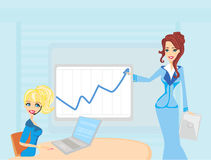 Three woman conducting a business meeting or presentation. Stock Photo