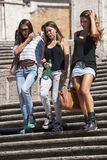 Three woman down spanish steps. Three beautiful Italian women down the steps of Trinità dei Monti at the Spanish square in Rome (Italy). They are extremely Stock Photo