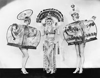 Three woman in ornate teapot costumes Royalty Free Stock Photos