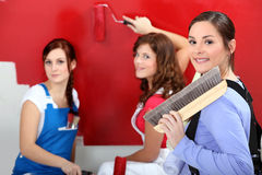 Three woman painting. Stock Images