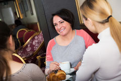 Three woman sitting in cafe Royalty Free Stock Image