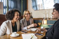 Three Woman Sitting Smiling Inside Room Stock Photos