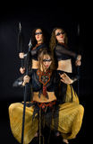 Three woman with spear Stock Images