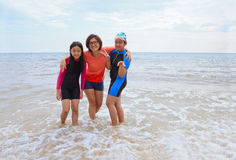 Three woman take a photo on sea beach with happiness emotion Stock Image
