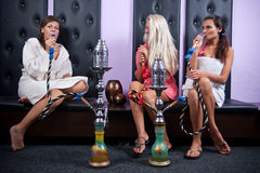 Three womans smoking hookah Royalty Free Stock Photo