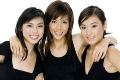 Three Women. Three attactive asian women in black tops on white background Royalty Free Stock Image
