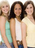 Three Women. A group of three attractive young women standing close together Royalty Free Stock Photography