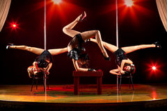 Three women acrobatic show Stock Photos