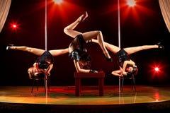 Three women acrobatic show Stock Photos