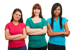 Three women with arms crossed stock photos
