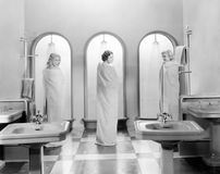 Three women in a bathroom together. (All persons depicted are no longer living and no estate exists. Supplier grants that there will be no model release issues royalty free stock images