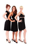 Three women black dresses Royalty Free Stock Images