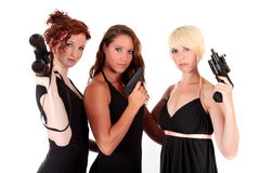 Three women black firearms Stock Photo