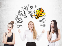 Three women brainstorming, question marks Stock Photo