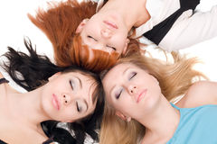 Three women with closed eyes Stock Image