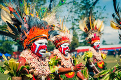 Three women in colours in Papua New Guinea stock photography