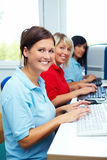 Three women with computers stock photography
