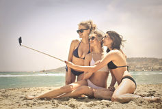 Three women doing a selfie. At the beach Royalty Free Stock Images