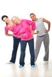 Three women doing sport. Three women young and senior doing sport over white background Stock Photo