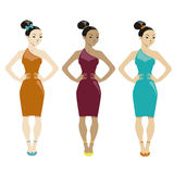 Three women in dresses on white background Royalty Free Stock Photos