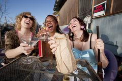 Three women drinking alcohol Royalty Free Stock Photo
