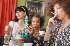 Three Women Drinking and Smoking Royalty Free Stock Photo