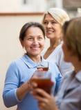 Three women drinking tea at balcony Stock Images