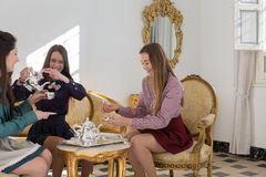 Three women drinking tea Stock Photography