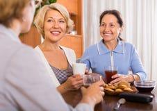 Three women drinking tea Royalty Free Stock Photos