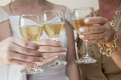 Three women drinking white wine Royalty Free Stock Photo